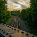 The sun setting across the rails as I cycled the…