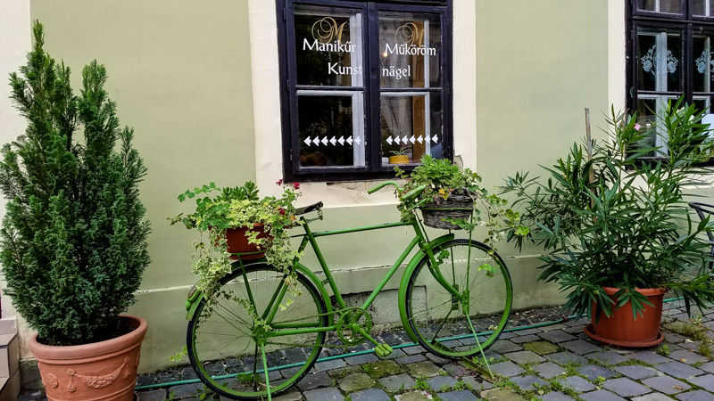 A bicycle in front of the coffee shop on the Koszeg town square