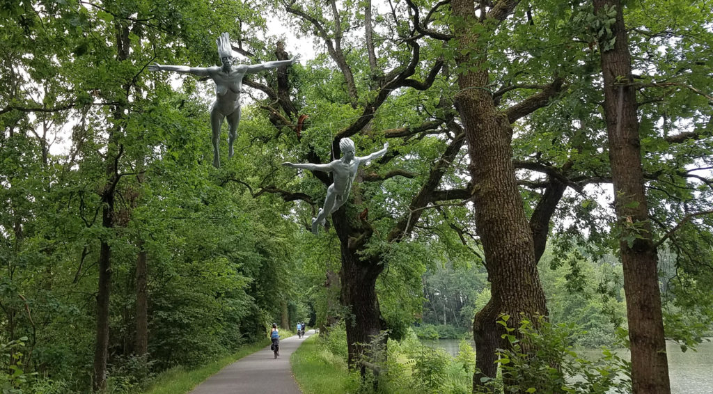 Sculptures flying above the cyclepath